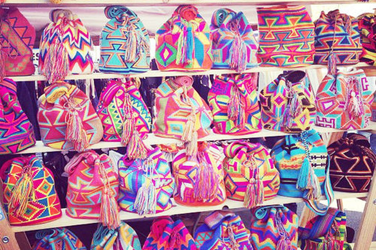 """Wayuu Tribe bags at DT Flea's colorful <a href=""""http://la.racked.com/archives/2013/07/29/27_colorful_snaps_from_the_downtown_fleas_epic_debut.php"""">debut</a>."""