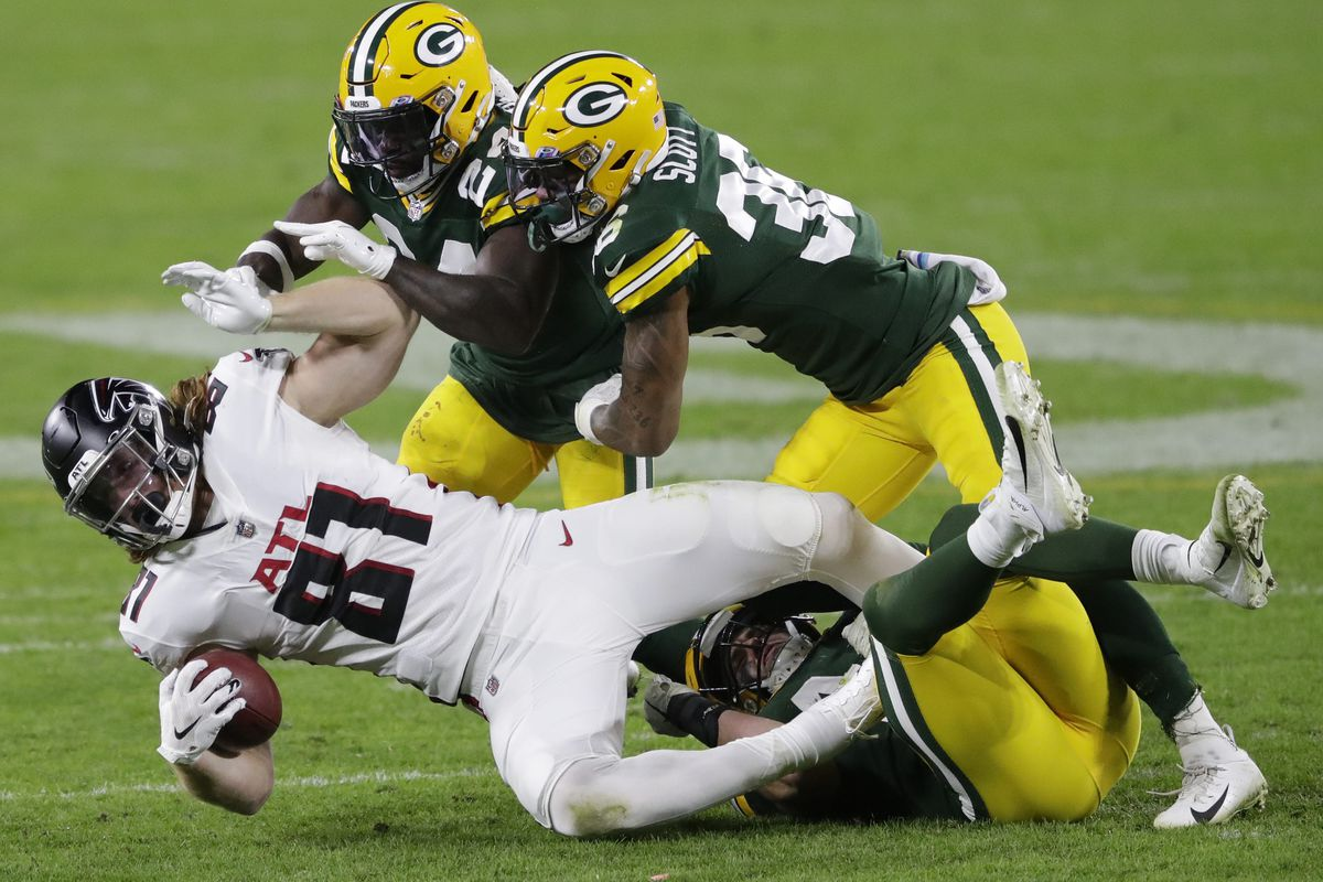 Atlanta Falcons tight end Hayden Hurst (81) is brought down by Green Bay Packers safety Raven Greene (24), Vernon Scott (36) and Ty Summers (44) during their football game Monday, October 5, 2020, at Lambeau Field in Green Bay, Wis.