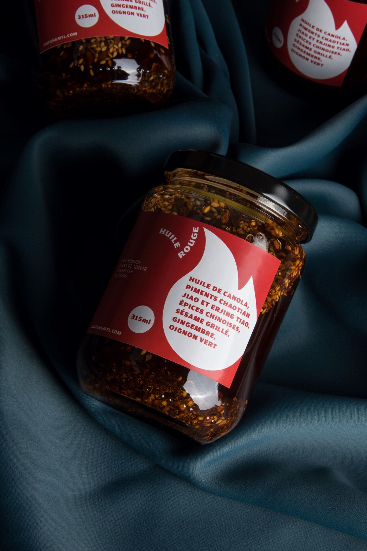 jars of chili oil with red label