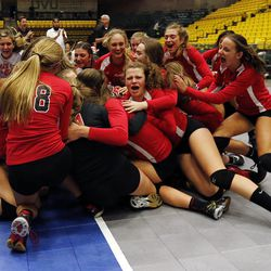 Park City celebrates winning the girls 4A high school volleyball state championship game in Orem on Thursday, Oct. 26, 2017. They defeated Sky View.