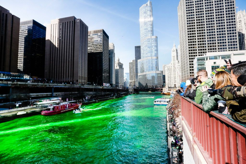 Members of the Chicago Journeymen Plumbers union use an environmentally friendly dye to turn the Chicago River emerald green. | James Foster/For the Sun-Times