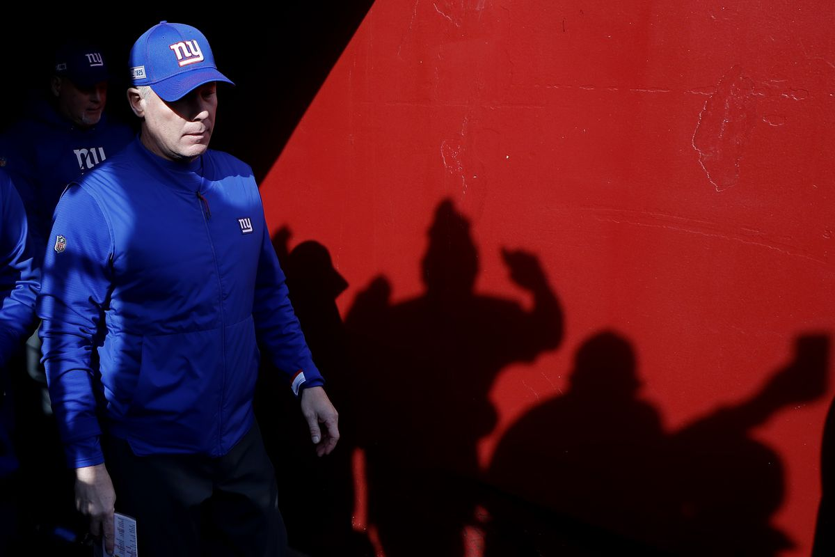 New York Giants head coach Pat Shurmur walks out of the tunnel onto the field prior to the Giants game against the Washington Redskins at FedExField.