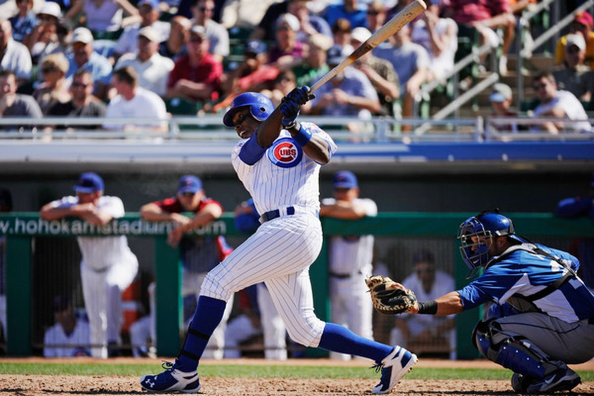 Alfonso Soriano of the Chicago Cubs swings at a pitch against the Kansas City Royals during the spring training baseball game at HoHoKam Stadium in Mesa, Arizona.  (Photo by Kevork Djansezian/Getty Images)