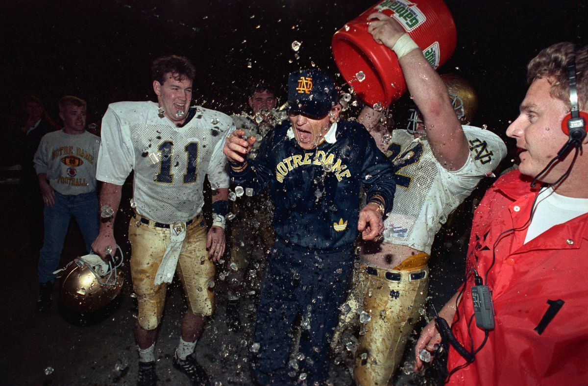 Bryan Flannery Pouring Bucket of Ice Water on Notre Dame Coach Lou Holtz