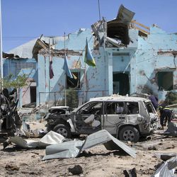 Somali security forces attend the scene of a car bomb attack in Mogadishu, Somalia Tuesday, June 20, 2017. A number of people are dead after a suicide car bomber in a vehicle posing as a milk delivery van detonated at a district headquarters in Somalia's capital, police said Tuesday.