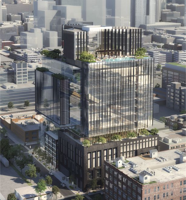 A mixed-use high-rise with a brick base, glassy upper floors, and a rooftop deck.