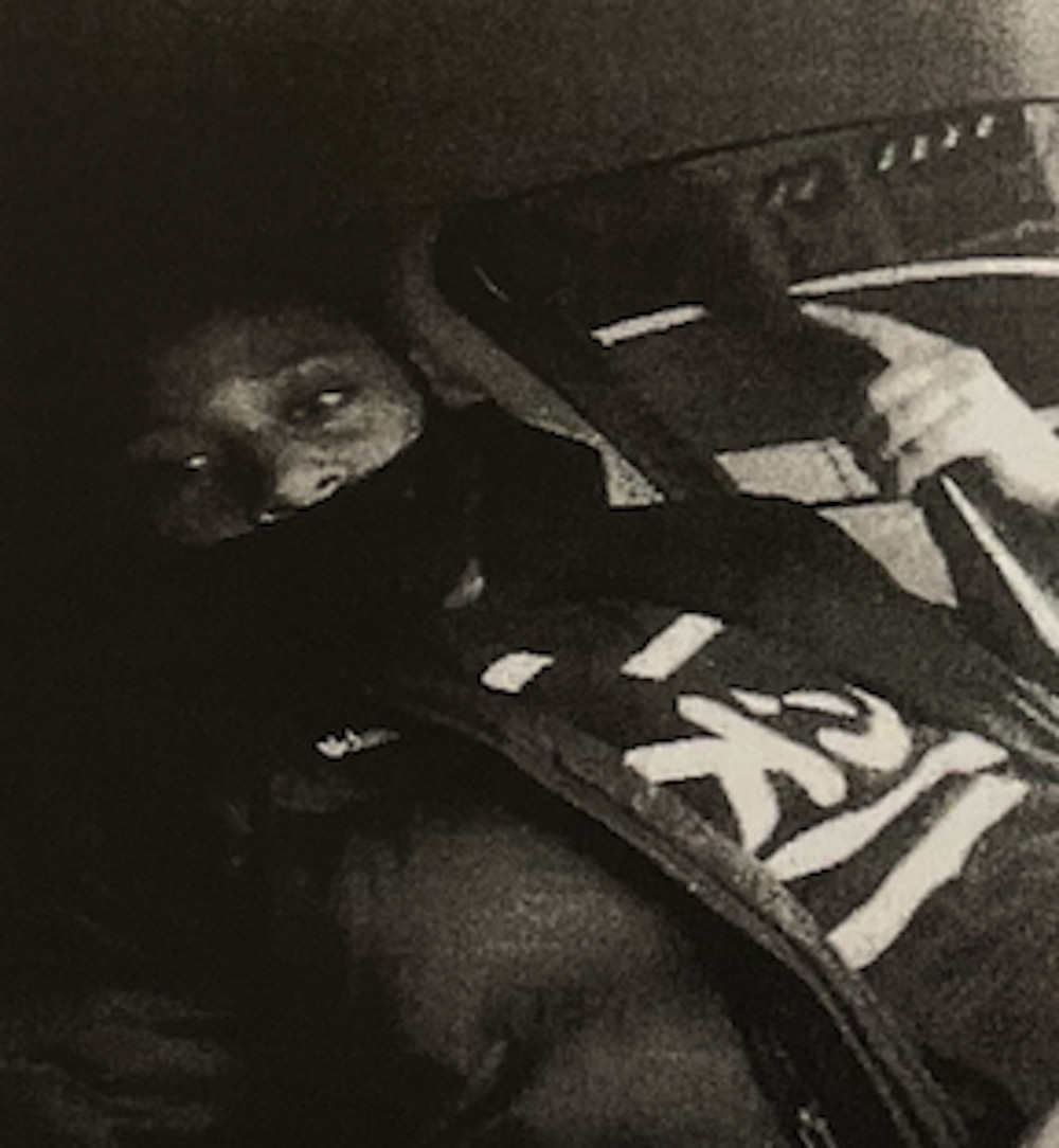 In a photo posted on social media, Edmond Harris displays a gun, according to federal authorities.