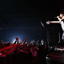 """Fans reach out to David Archuleta as he sings to a sold-out crowd at the E Center in West Valley City on Friday. Archuleta is promoting his first studio album, """"David Archuleta,"""" which was released in November and has sold more than half a million copies."""
