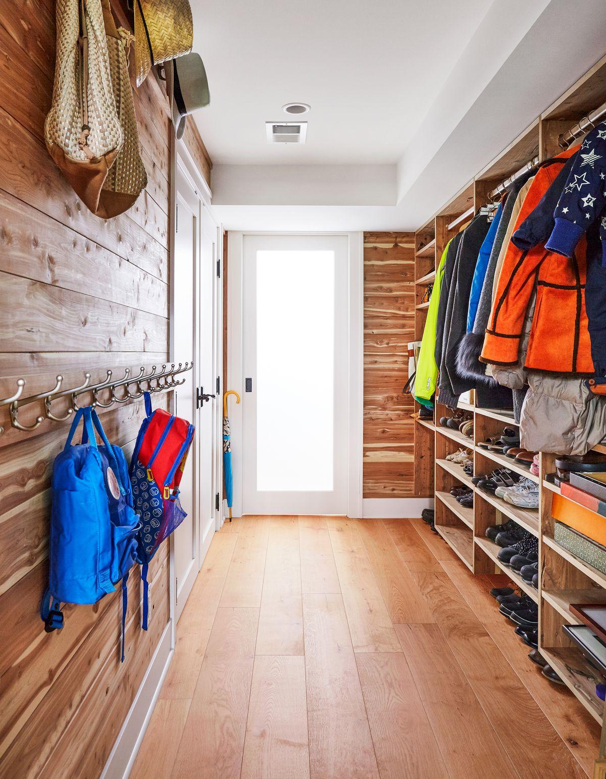 Cedar mudroom with shoe storage.