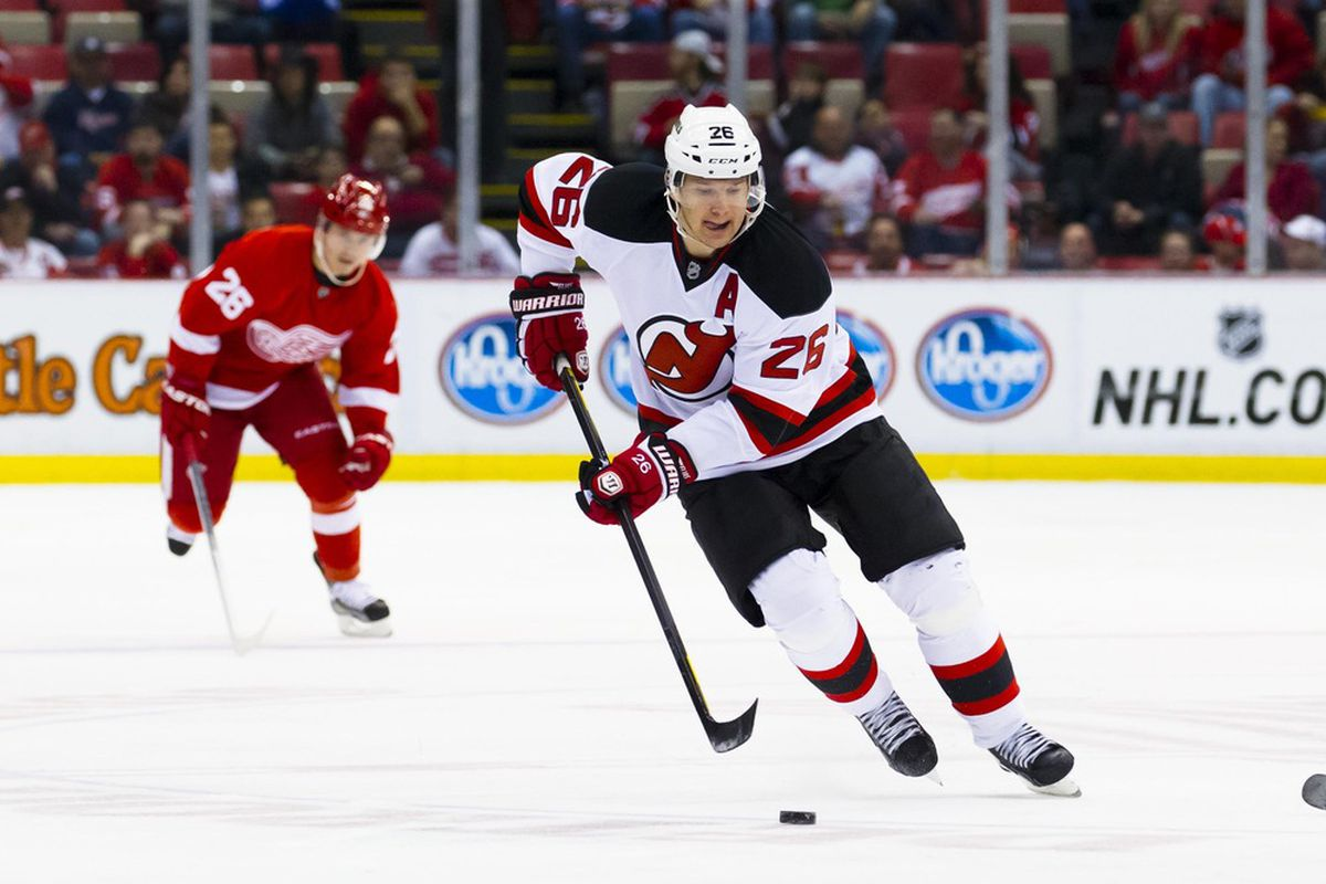 Here's a picture of Patrik Elias skating away from a Red Wing. This picture was from April 2012.  Yes, 2012.