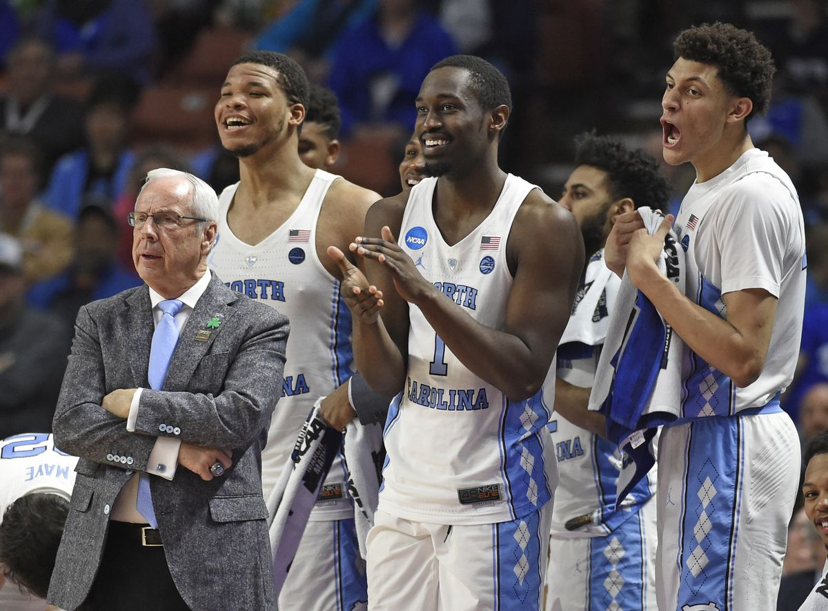 University of North Carolina coach Roy Williams (left) and players Kennedy Meeks, Theo Pinson and Justin Jackson wrap up an NCAA first-round win against Texas Southern on March 17 in Greenville, South Carolina. The NCAA moved games from Greensboro, North