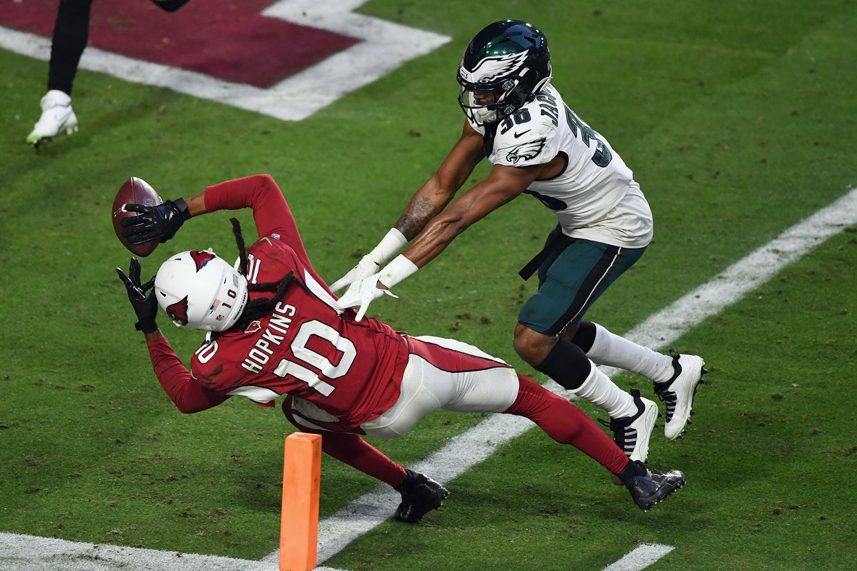 DeAndre Hopkins #10 of the Arizona Cardinals makes the catch and scores during the fourth quarter against Michael Jacquet #38 and the Philadelphia Eagles at State Farm Stadium on December 20, 2020 in Glendale, Arizona. The Cardinals defeated the Eagles 33-26.