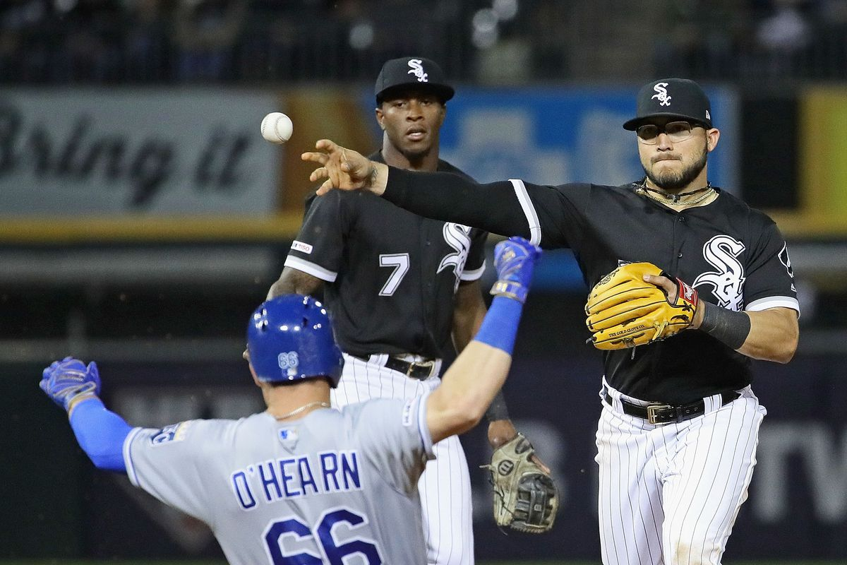 Yolmer Sanchez #5 of the Chicago White Sox turns a double play over Ryan O'Hearn #66 of the Kansas City Royals in the 6th inning at Guaranteed Rate Field on May 29, 2019 in Chicago, Illinois.