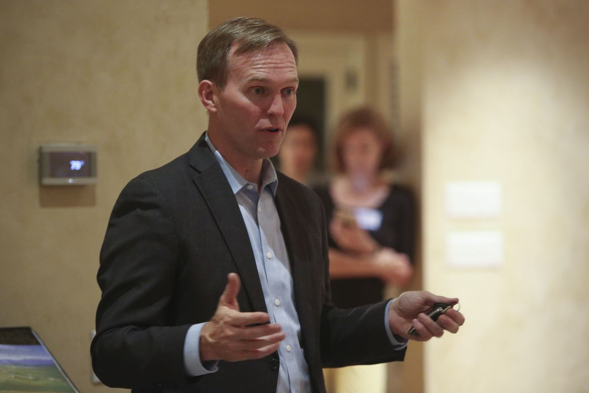Salt Lake County Mayor Ben McAdams, 4th Congressional District Democratic candidate, speaks at a neighborhood gathering in Millcreek on Monday, Oct. 1, 2018.