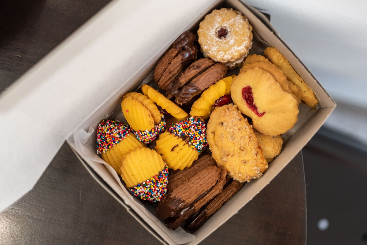 An overhead shot of baked goods from a Jewish bakery in a white box.