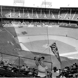 FILE - In this file photo of Sept. 22, 1957, two days before the Brooklyn Dodgers played their last game at Ebbets Field, a  young Dodgers fan waves a banner in the stadium as the Dodgers played the Philadelphia Phillies in Brooklyn, N.Y. It was like a death in the family for Brooklyn baseball fans when their beloved Dodgers left the borough behind for the California coast. But after decades without a professional sports team, Brooklyn is hitting the major leagues again on Friday, Sept. 21, 2012 when the Brooklyn Nets' new arena opens to the public.