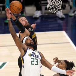 Utah Jazz forward Royce O'Neale (23) battles Memphis Grizzlies center Jonas Valanciunas (17) for a rebound as the Utah Jazz and the Memphis Grizzlies play in game one of their NBA playoff series at Vivint Arena in Salt Lake City on Sunday, May 23, 2021.