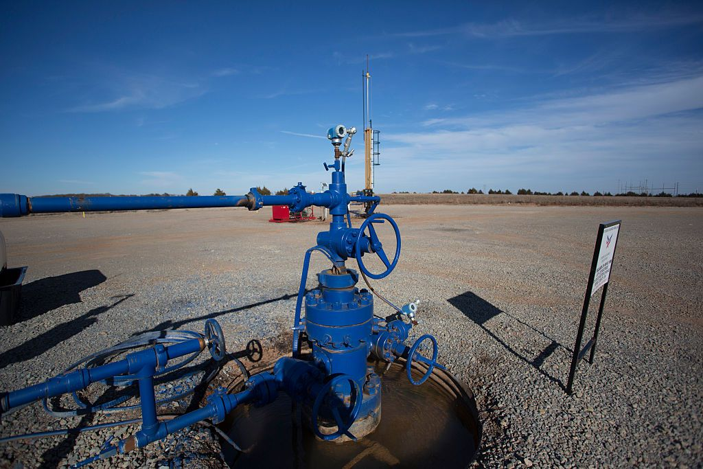 An injection wells pumps waste water into the ground , January 24, 2016 in Coyle, Oklahoma. Oklahoma has 4,200 injection wells. (J. Pat Carter/Getty Images)