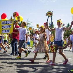 Kids walk behind the Sandy Utah Willow Creek Stake float during the Days of '47 Union Pacific Railroad Youth Parade held Saturday, July 18, 2015, in Salt Lake City.