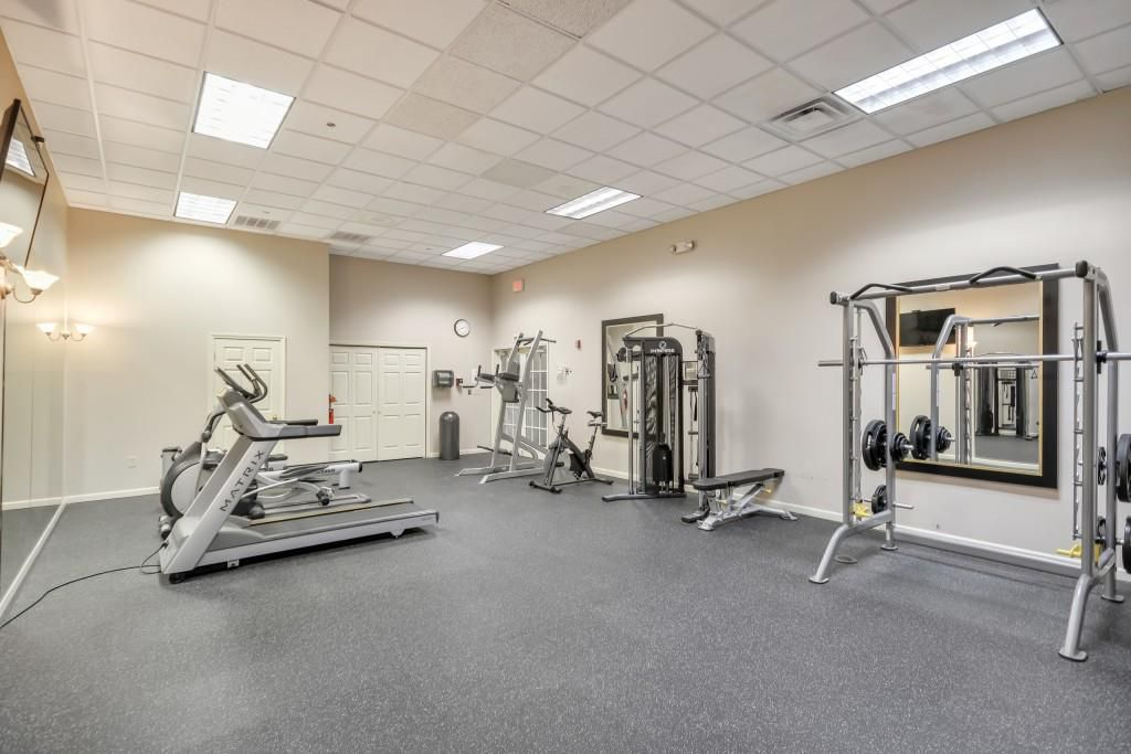 A little gym with beige walls.