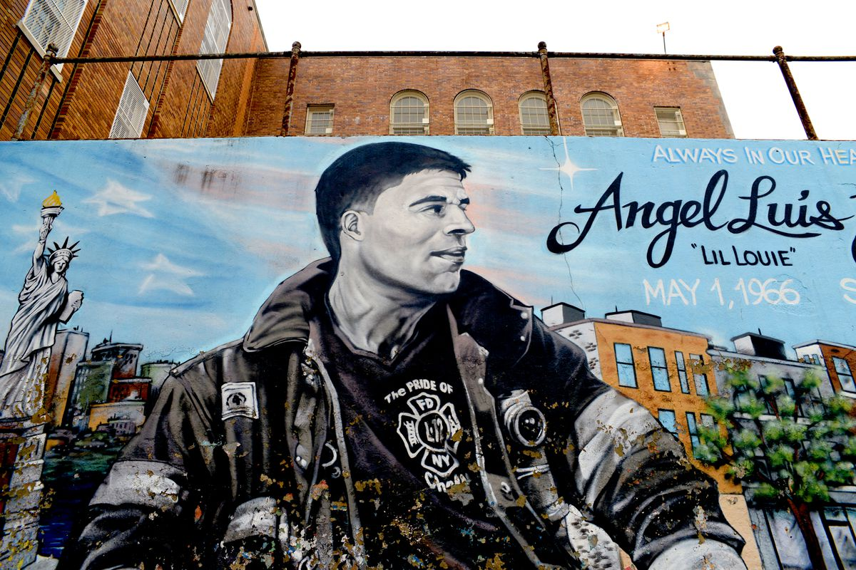 Another handball wall, near St. Mary's Park in the Bronx, honoring Angel Luis Juarbe, a firefighter with Ladder 12 in Chelsea who died in the Sept. 11 attacks. This was painted by a group of artists known as The Mural Kings/Tats Cru, who have painted other murals honoring 9/11 victims including one this week in Sacramento.