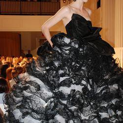 Coco Rocha in black silk faille and black point d'esprit ruffle gown.