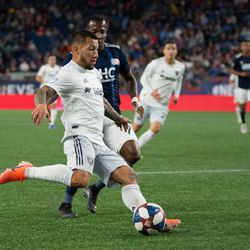 FOXBOROUGH, MA - MAY 25: D.C. United midfielder Luciano Acosta #10 sends a cross into the box against the New England Revolution at Gillette Stadium on May 25, 2019 in Foxborough, Massachusetts. (Photo by J. Alexander Dolan - The Bent Musket)