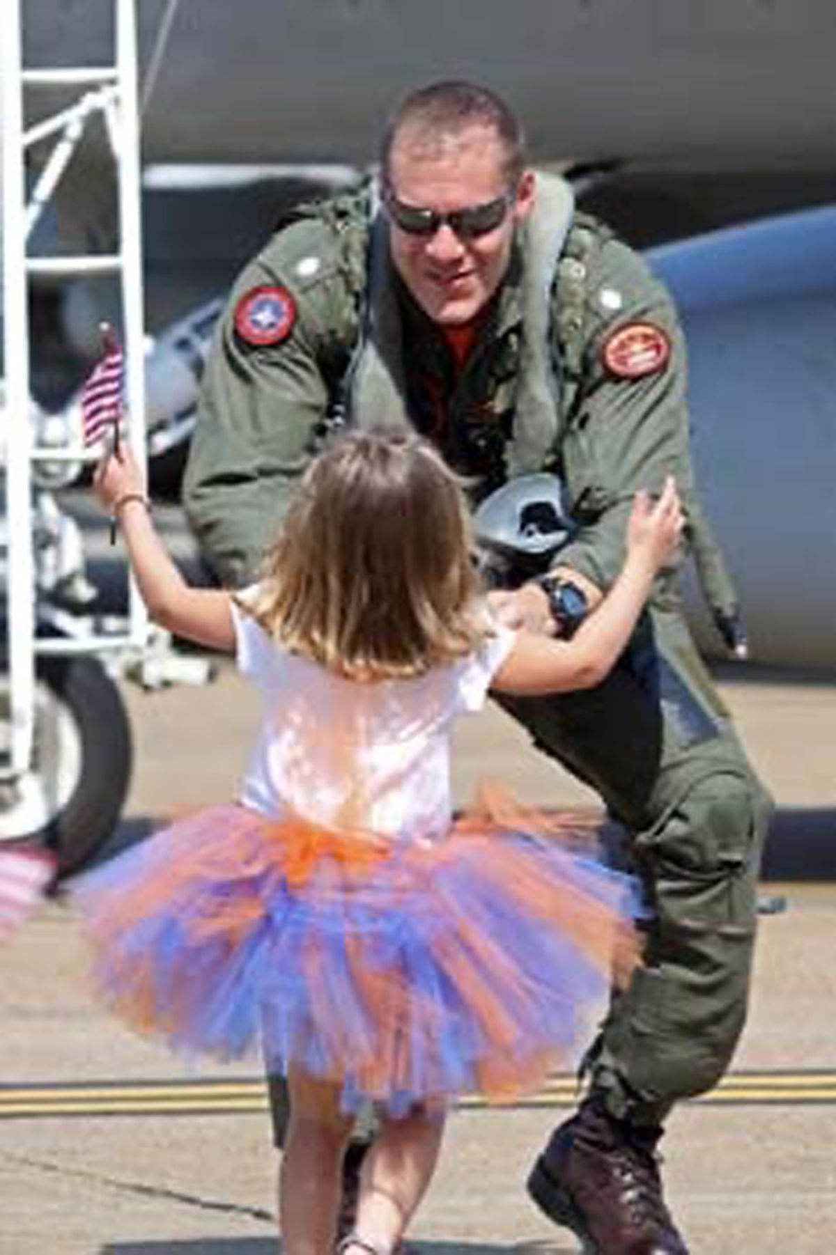 John Capizzi greets one of his then-young daughters in 2010 in Virginia Beach, Virginia. Years later, the retired Navy commander successfully fought the VA to be able to use his Post-9/11 GI Bill benefits to pay for college for his two daughters, who are now in high school.