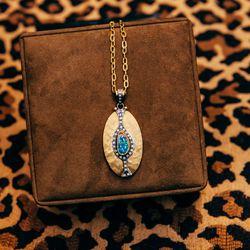 <b>Annie Fensterstock</b> opal necklace, $5,490.