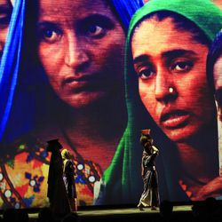 Backdropped by a projected picture of refugees, actors perform during the opening ceremony of the World Humanitarian Summit, in Istanbul, Monday, May 23, 2016. World leaders and representatives of humanitarian organisations from across the globe converge in Istanbul on May 23-24, 2016 for the first World Humanitarian Summit, focused on how to reform a system many judge broken.