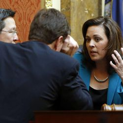 House Speaker Becky Lockhart, R-Provo, talks with Rep. Dean Sanpei, R-Provo, left, and Rep. Jim Dunnigan, R-Taylorsville, before the afternoon session in the House of Representatives begins at the Utah Capitol in Salt Lake City on Monday, Jan. 27, 2014. Lockhart, the first woman to serve as Utah House speaker, died at her home Saturday, Jan. 17, 2015, from an unrecoverable and extremely rare neurodegenerative brain disease. Lockhart she was 46.