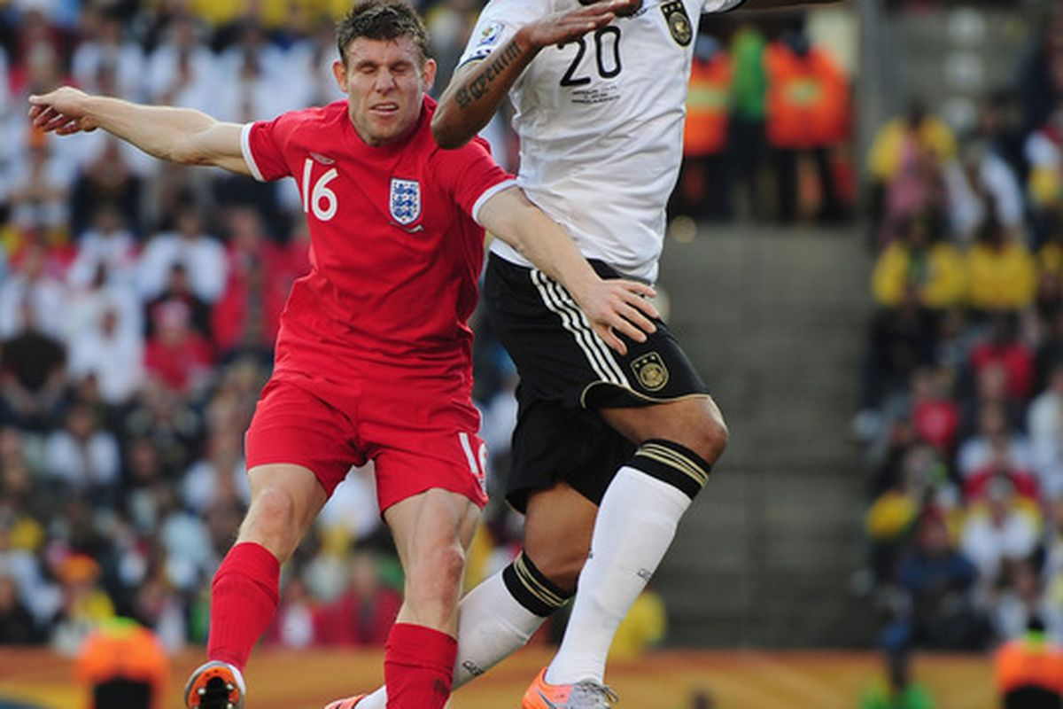 New City teammates James Milner and Jerome Boateng in action at the World Cup.