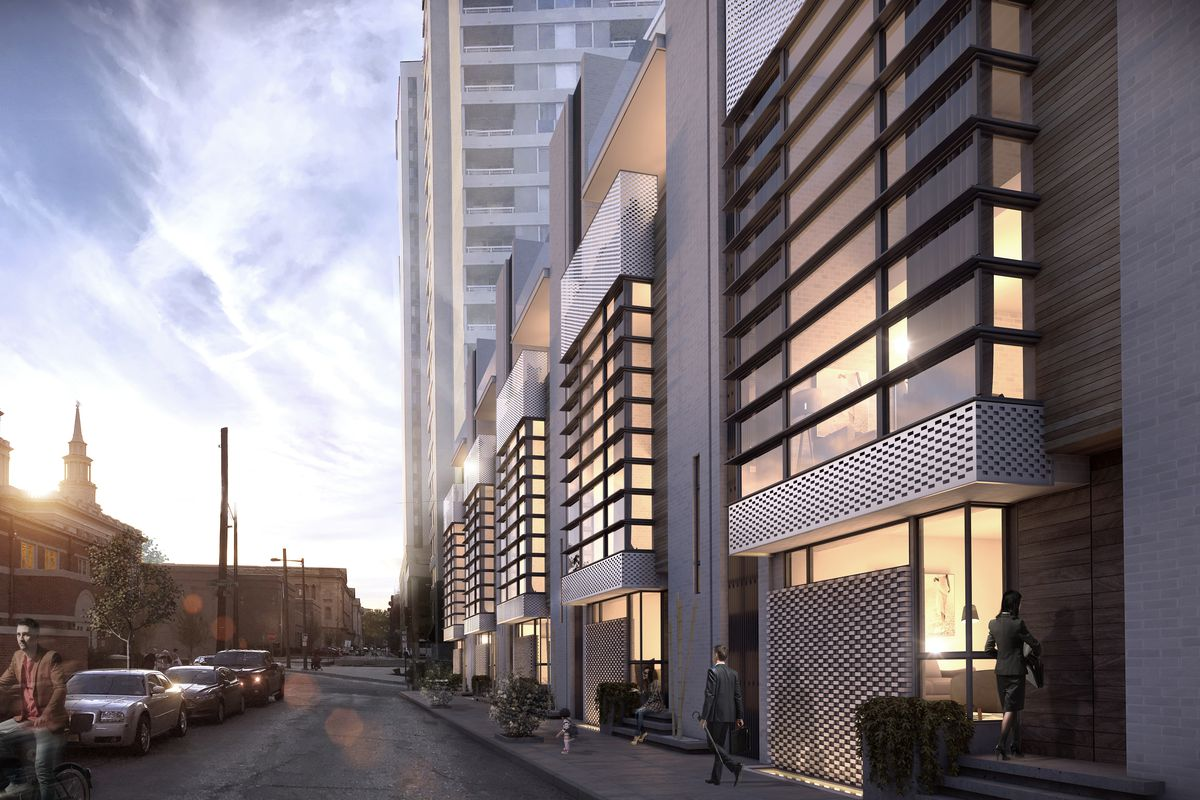 A rendering of a series of contemporary townhomes lit up at night.