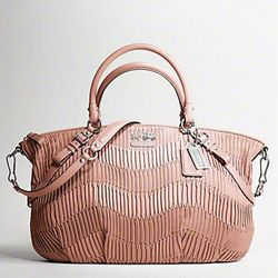 "Coach Spring '11: <a href=""http://www.coach.com/online/handbags/-handbags_silhouettes_satchels-10551-10051-5000000000000015033-en?t1Id=62&t2Id=5000000000000015033&tier=2&LOC=CC"" rel=""nofollow"">Madison</a> Gathered Leather Large Sophia Satchel"