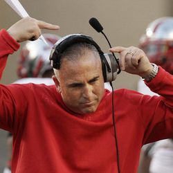 Rutgers coach Kyle Flood adjusts his headset during the first quarter of an NCAA college football game against Arkansas in Fayetteville, Ark., Saturday, Sept. 22, 2012.