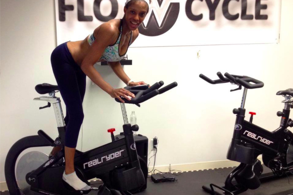 """Instructor AC on the studio's bike; Image via Facebook/<a href=""""https://www.facebook.com/flowcyclenow/photos_stream"""">Flow Cycle</a>"""