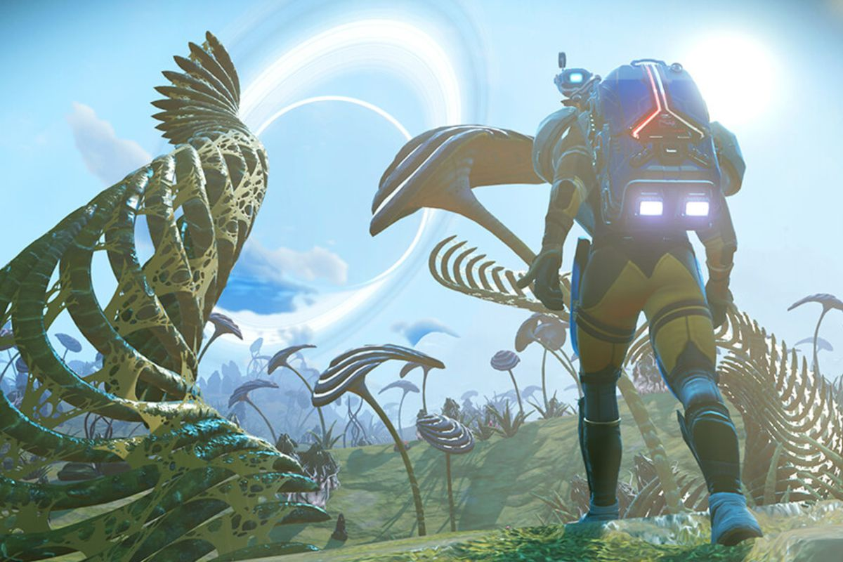 No Man's Sky - a player stands on a planet full of big flora, and another planet is distant in the sky.