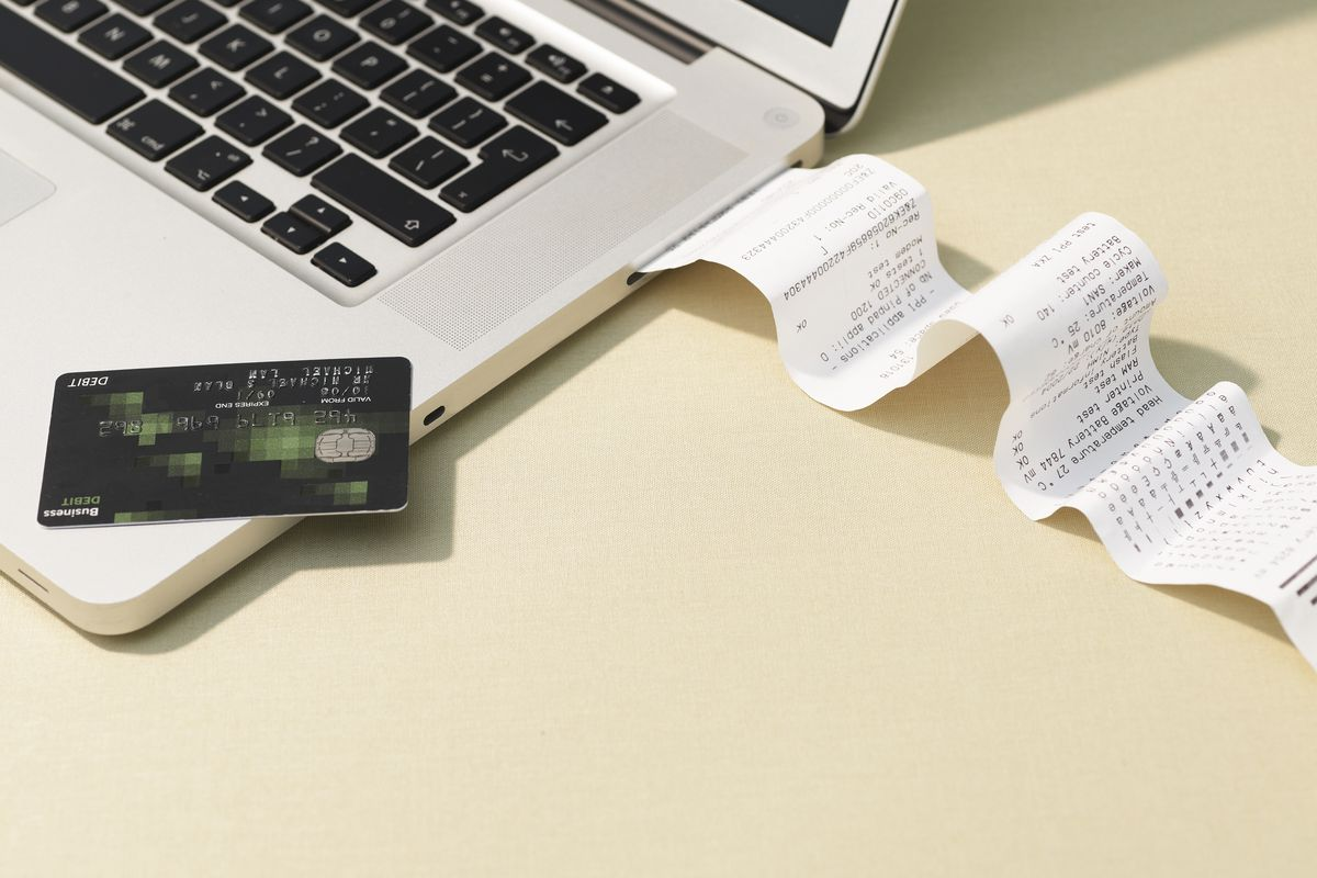 A credit card, a receipt, and a laptop.