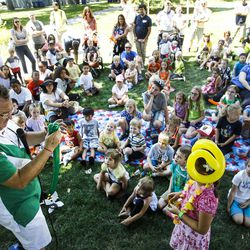 Kids enjoy a magic show preformed by Paul Brewer, left, at The Days of '47 Family Festival in Salt Lake City on Saturday, July 23, 2016.