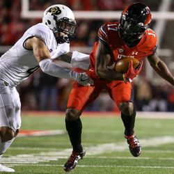 Utah Utes wide receiver Demari Simpkins (17) evades the tackle from Colorado Buffaloes defensive back Dante Wigley (4) at Rice-Eccles Stadium in Salt Lake City on Saturday, Nov. 25, 2017.