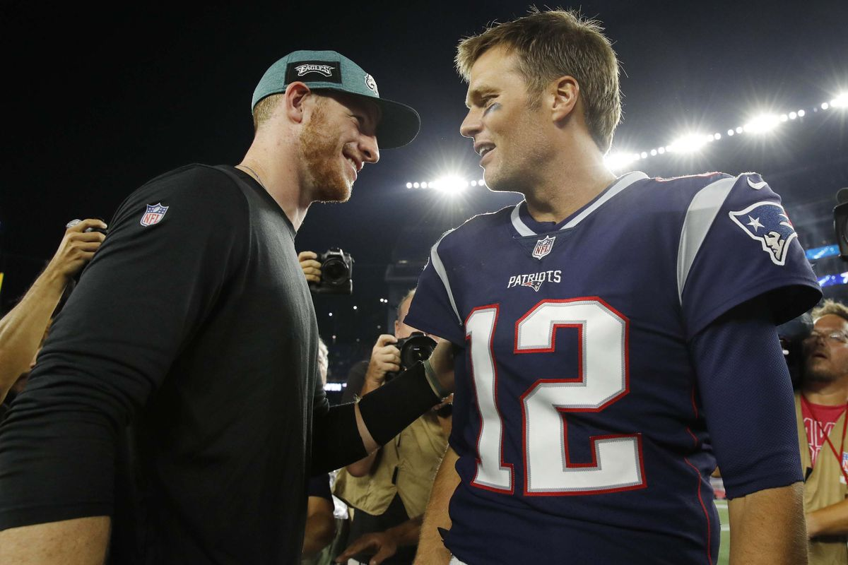 New England Patriots quarterback Tom Brady meets Philadelphia Eagles quarterback Carson Wentz after the game at Gillette Stadium. Patriots defeated the Eagle 37-20.
