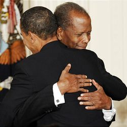 President Barack Obama embraces actor Sidney Poitier after presenting him with the Presidential Medal of Freedom Wednesday.