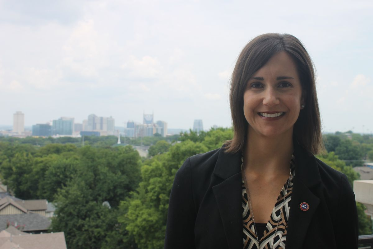 Sara Morrison poses for a portrait with the Nashville skyline in the background.