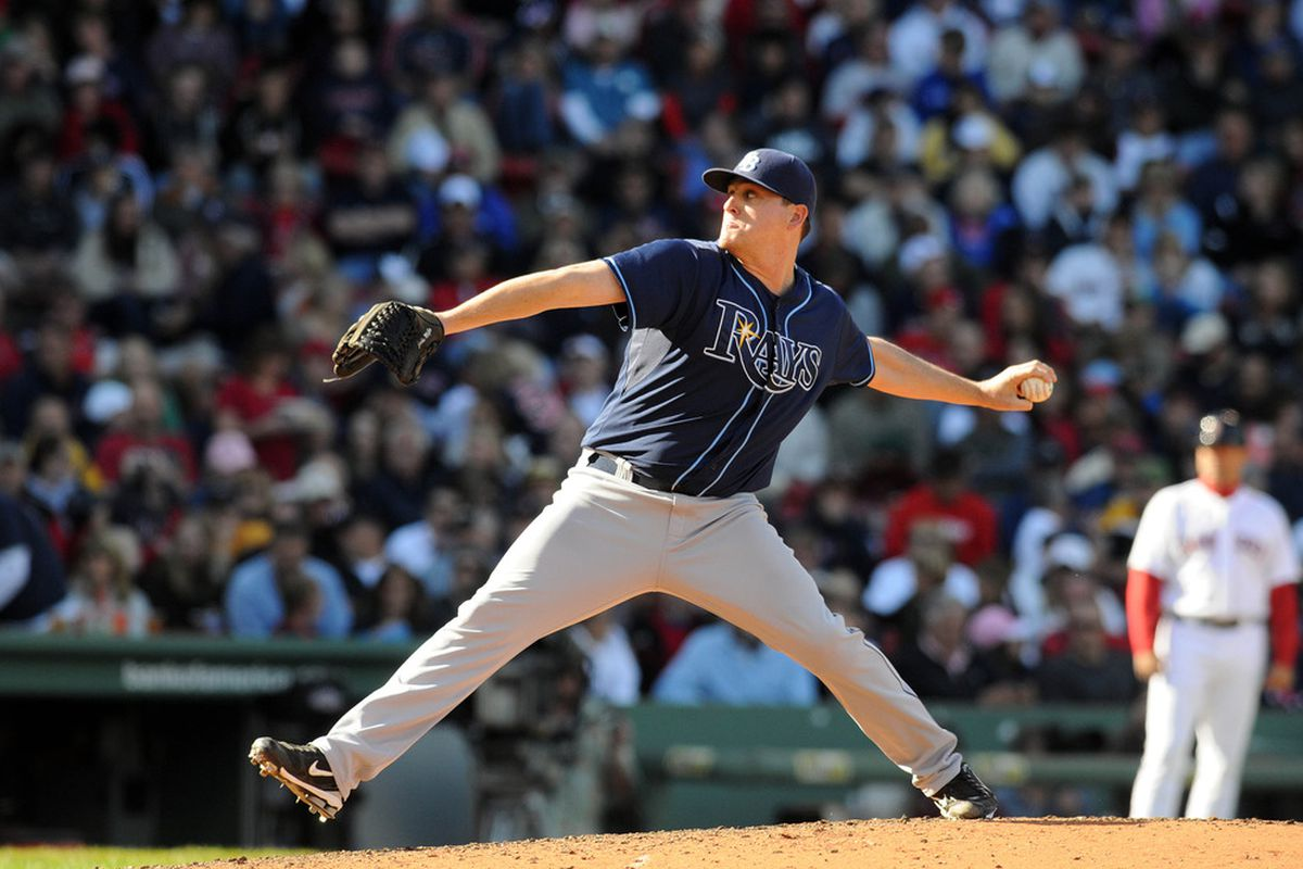 BOSTON, MA - SEPTEMBER 18:  Jake McGee #57 of the Tampa Bay Rays throws a pitch in the fifth inning against the Boston Red Sox at Fenway Park on September 18, 2011 in Boston, Massachusetts.(Photo by Darren McCollester/Getty Images)