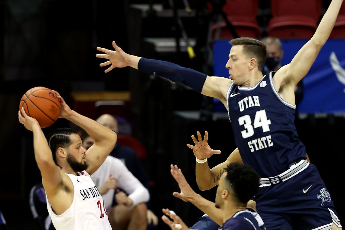 Utah State Aggies forward Justin Bean (34) tries to defend San Diego State Aztecs guard Jordan Schakel (20) as Utah State and San Diego State play in the championship game of the Mountain West Tournament at the Thomas & Mack Center in Las Vegas on Saturday, March 13, 2021.