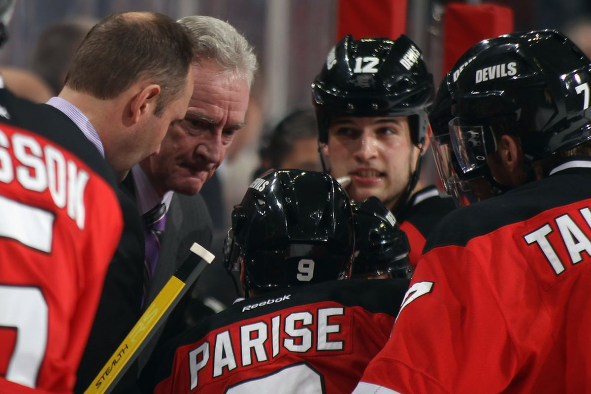 """""""OK, boys, here's the plan - psst psst psst...""""  """"That's not a plan, you just said 'psst psst psst...' !""""  """"Well, then, onto Plan B!"""" (Photo by Bruce Bennett/Getty Images)"""