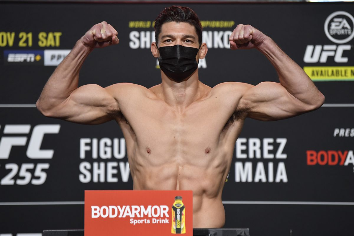 Alan Jouban poses on the scale during the UFC 255 weigh-in at UFC APEX on November 20, 2020 in Las Vegas, Nevada.