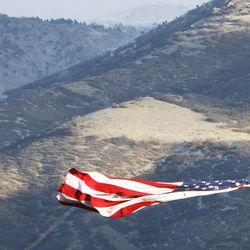 A flag blows in the wind in Farmington, Thursday, Dec. 1, 2011.