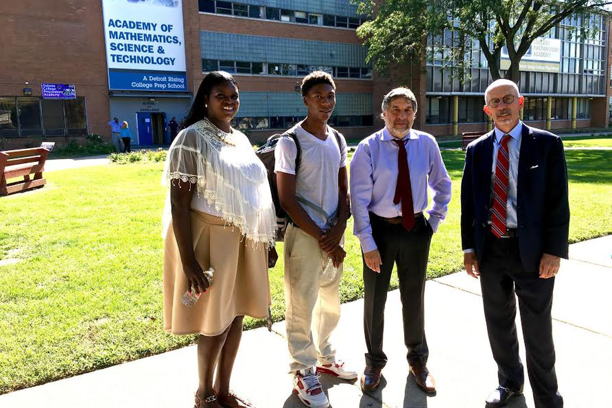 Attorneys behind a new federal civil rights lawsuit meet with Osborn High School college advisor Andrea Jackson and student Jamarria Hall.