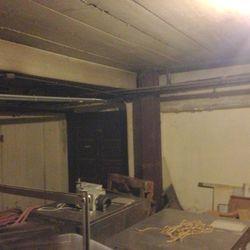 An adjacent room, underground.